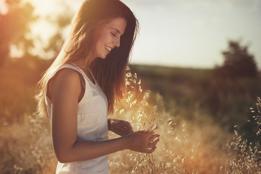 Girl smiling in a field